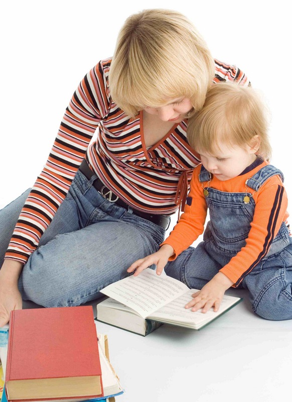 pretty baby and mother read the books over white background