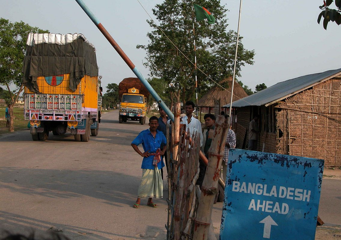 Bangladeshi labouerers are waiting for Indian Trucks, which have carried the goods for Bangladesh at Chengrabandha, the authorised International Border Check Post (IBCP) on India-Bangladesh International Border in Coochbehar District of Northeast Indian State West Bengal. Pix-Shib Shankar Chatterjee.