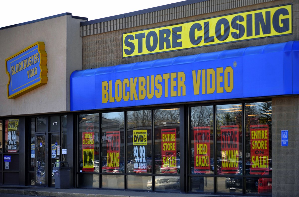 FILE - This March 17, 2010, file photo, shows a closing Blockbuster stores in Racine, Wis. Dish Network announced Wednesday, Nov. 6, 2013, it will close the remaining 300 Blockbuster locations scattered across the United States. Dish Network expects the stores to be closed by early January. Dish Network says about 2,800 people will lose their jobs. (AP Photo/Journal Times, Scott Anderson, File)